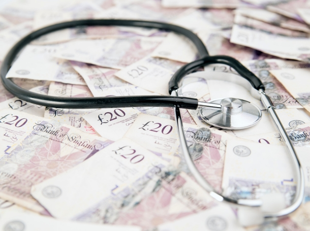 A stethoscope on top of 20-pound Bank of England notes