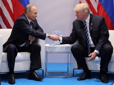 U.S. President Donald Trump shakes hands with Russia's President Vladimir Putin during their bilateral meeting at the G20 summit in Hamburg, Germany, July 7, 2017