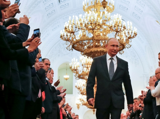 Russian President Vladimir Putin walks before an inauguration ceremony at the Kremlin in Moscow, May 7, 2018