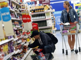 Shoppers browse aisles in a supermarket in London, Britain, April 11, 2017