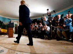 U.S. President Trump arrives to announce his decision to withdraw from the JCPOA Iran nuclear agreement in the Diplomatic Room of the White House, May 8, 2018