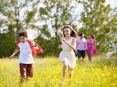 Family walking in a flower field