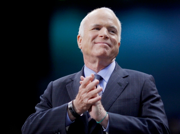 United States Republican presidential nominee Senator John McCain (R-AZ) listens as he is introduced at a campaign rally in Fayetteville, North Carolina, October 28, 2008