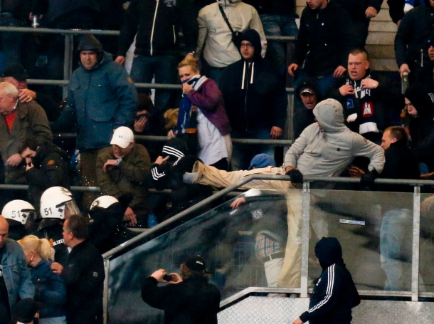 German riot police enter the Hamburg SV supporters' block during a break in their German Bundesliga first division soccer match against Bayern Munich in Hamburg, Germany, May 3, 2014
