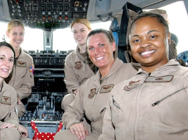 Airman 1st Class Summer Toney, 1st Lt. Ashley Guthrie Capt. Kate Bufton, Capt. Emily Nelson, Tech. Sgt. Lori Tascione and Staff Sgt. Krysteena Scales make up an 816th Expeditionary Airlift Squadron flight crew, March 19, 2005
