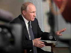 Russia's President Vladimir Putin speaks during an interview with Fox News after a meeting with U.S. President Donald Trump in Helsinki, Finland, July 16, 2018