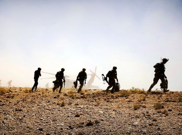 Soldiers set off for a foot patrol after disembarking from a UH-60 Black Hawk helicopter in Afghanistan, September 4, 2018