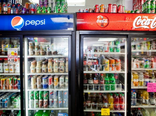 Cans of soda are displayed in a case at Kwik Stops Liquor in San Diego, California, February 13, 2014