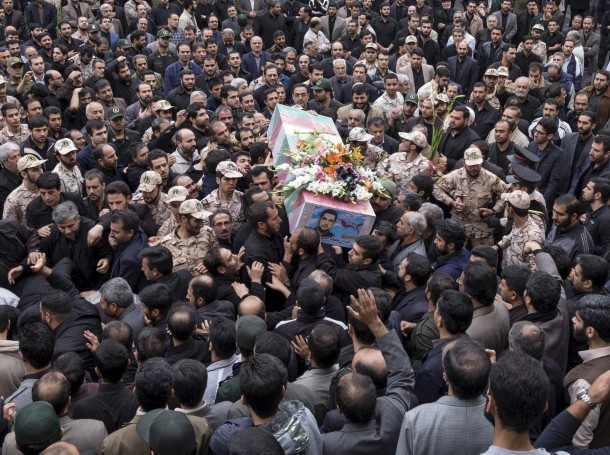 Mourners carry the coffin of Amin Karimi, a member of Iranian Revolutionary Guards who was killed in Syria, during his funeral in Tehran, October 28, 2015