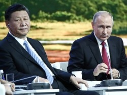 Russian President Vladimir Putin and Chinese President Xi Jinping attend a session of the Eastern Economic Forum in Vladivostok, Russia September 12, 2018