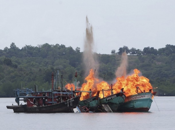 Malaysian and Vietnamese fishing boats are destroyed for illegal fishing by the Ministry of Maritime Affairs and Fisheries, police and navy, in Batam, Riau Islands, Indonesia, April 5, 2016