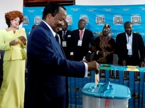 Cameroonian President Paul Biya casts his ballot while his wife Chantal Biya watches at a polling station during the presidential election in Yaounde, Cameroon October 7, 2018
