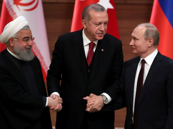 Presidents Hassan Rouhani of Iran, Recep Tayyip Erdogan of Turkey, and Vladimir Putin of Russia hold a joint news conference after their meeting in Ankara, April 4, 2018
