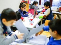 Children of a welcome class for migrants attend a German language lesson at the Catholic Sankt Franziskus school in Berlin, Germany, January 22, 2016