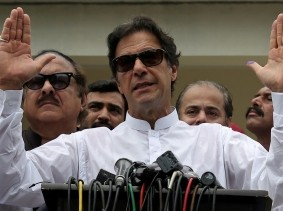 Imran Khan, chairman of Pakistan Tehreek-e-Insaf, speaks to members of media after voting in the general election in Islamabad, Pakistan, July 25, 2018