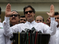 Imran Khan, chairman of Pakistan Tehreek-e-Insaf, speaks to members of media after voting in the general election in Islamabad, Pakistan, July 25, 2018