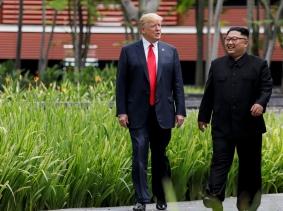 U.S. President Donald Trump and North Korea's leader Kim Jong Un walk at the Capella Hotel on the island of Sentosa, Singapore, June 12, 2018