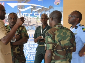 Participants speak during a coffee break at Africa Endeavor 2018 in Santa Maria, Sal, Cabo Verde