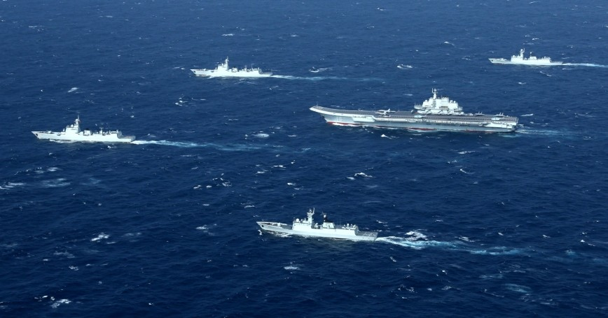 China's Liaoning aircraft carrier with accompanying fleet conducts a drill in an area of South China Sea, December, 2016
