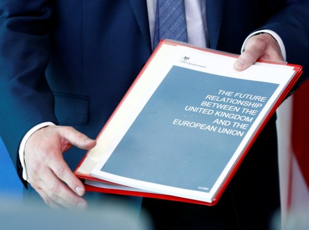 Britain's Secretary of State for Exiting the European Union, Dominic Raab, holds documents ahead of a meeting in Brussels, Belgium, July 19, 2018