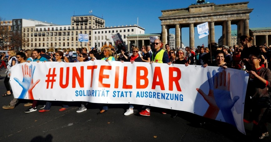 Protesters gather to the #unteilbar demonstration in Berlin, Germany, October 13, 2018