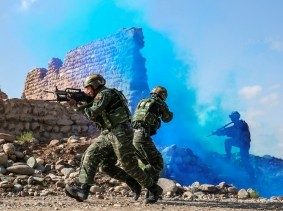 Chinese People's Liberation Army soldiers take part in a combat training in the Gobi desert in Jiuquan, Gansu province, China, May 18, 2018
