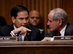 Senators Marco Rubio (left) and Jim Risch speak at a Senate Foreign Relations Committee hearing on Capitol Hill, June 13, 2017