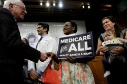 Senator Bernie Sanders greets attendees before an event to introduce the Medicare for All Act of 2017 on Capitol Hill in Washington, September 13, 2017