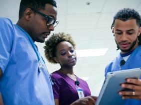 Nurses discussing patient records