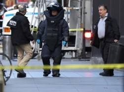 A member of the NYPD bomb squad walks outside the Time Warner Center in Manhattan after a suspicious package was found at CNN headquarters, New York City, October 24, 2018, photo by Kevin Coombs/Reuters