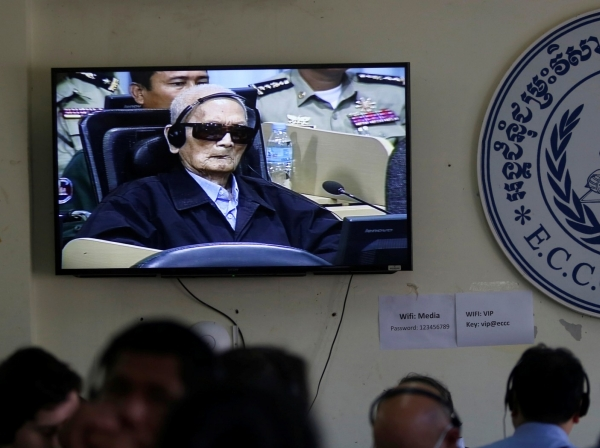 Former Khmer Rouge leader Nuon Chea is seen on a television screen as he waits for a verdict in Phnom Penh, Cambodia, November 16, 2018