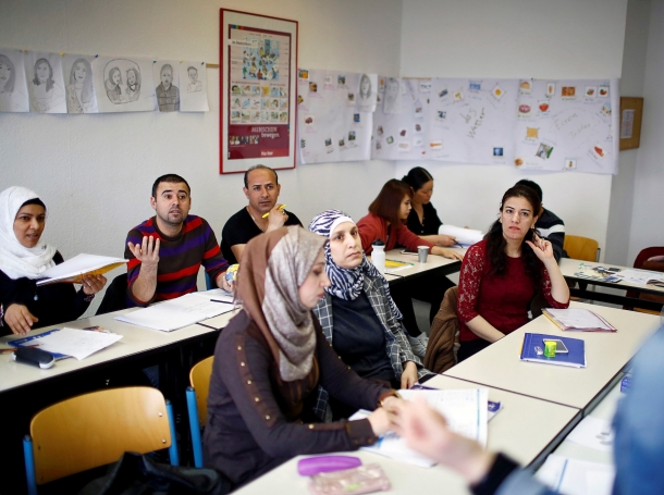Migrants attend a lesson at the 'institute for intercultural communication' in Berlin, Germany, April 13, 2016