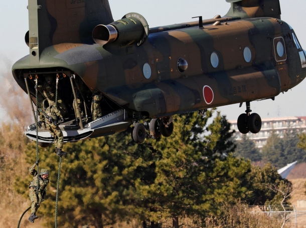 Members of Japan's Ground Self-Defense Force 1st Airborne Brigade descend from a CH-47 helicopter during an annual new year military exercise at Narashino exercise field in Funabashi, east of Tokyo, Japan, January 12, 2018