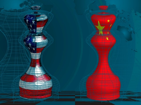 Chess pieces with U.S. and China flags superimposted on world map background