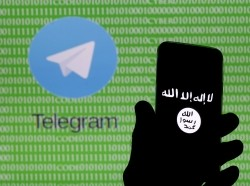 A smartphone showing the Islamic State logo in front of a screen showing the Telegram logo in Zenica, Bosnia and Herzegovina, November 18, 2015