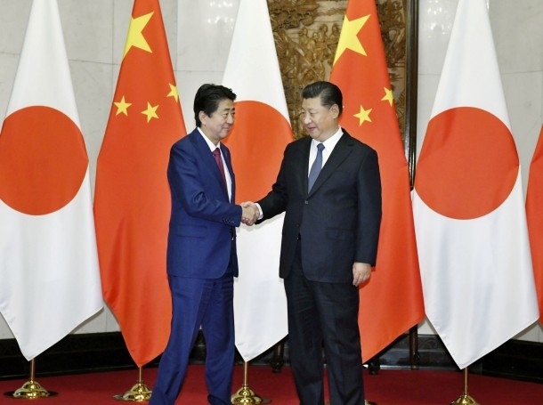 Japan's Prime Minister Shinzo Abe (L) shakes hands with China's President Xi Jinping during a meeting in Beijing, China, October 26, 2018
