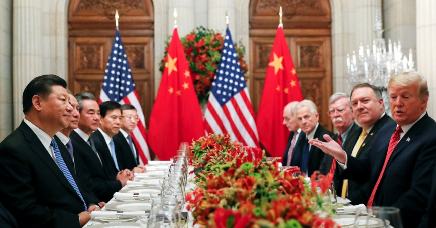 U.S. President Donald Trump, U.S. Secretary of State Mike Pompeo, U.S. President Donald Trump's national security adviser John Bolton and Chinese President Xi Jinping attend a working dinner after the G20 leaders summit in Buenos Aires, Argentina, December 1, 2018