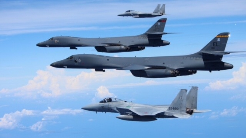 Japan's Self-Defense Forces F-15 fighter jets (top and bottom) conduct an exercise with U.S. Air Force B-1B Lancer bombers above the East China Sea, Japan, September 9, 2017