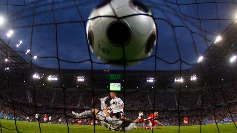 Germany's Lukas Podolski scores past Poland's goalkeeper Artur Boruc at the Woerthersee Stadium in Klagenfurt, Austria, June 8, 2008