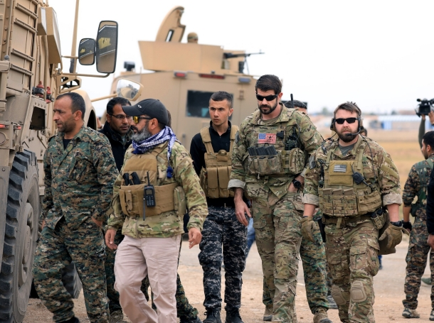 Syrian Democratic Forces and U.S. troops are seen during a patrol near Turkish border in Hasakah, Syria, November 4, 2018
