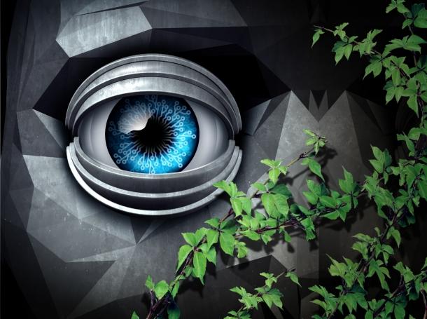 Artificial eye looking through greenery