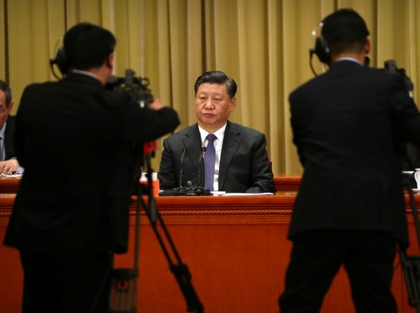 """Chinese President Xi Jinping listens to a speech during an event to commemorate the 40th anniversary of the """"Message to Compatriots in Taiwan"""" at the Great Hall of the People in Beijing, China, January 2, 2019"""