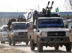 A Turkish-backed Syrian rebel rides on a truck with a mounted weapon at Manbij countryside, Syria, December 28, 2018