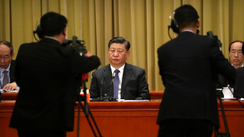 "Chinese President Xi Jinping listens to a speech during an event to commemorate the 40th anniversary of the ""Message to Compatriots in Taiwan"" at the Great Hall of the People in Beijing, China, January 2, 2019"