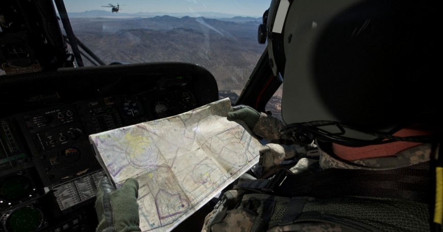 A helicopter co-pilot reads a map en route to Playas Training Area, New Mexico during exercise Angel Thunder 2013, photo by Stocktrek Images/Getty Images