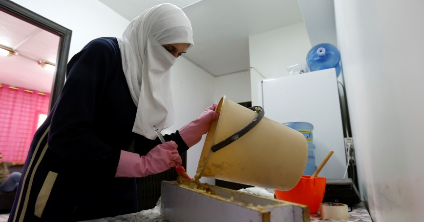 Um Akram, a Syrian refugee, creates soap under Jasmine, a project which hires and trains Syrian refugee women to create handicrafts, in Amman, Jordan, July 11, 2016