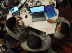 Hawaii Air National Guardsmen evaluate network vulnerabilities during the Po'oihe 2015 Cyber Security Exercise at the University of Hawaii Manoa Campus, Honolulu, HI, June 4, 2015, photo by Airman 1st Class Robert Cabuco/Hawaii Air National Guard