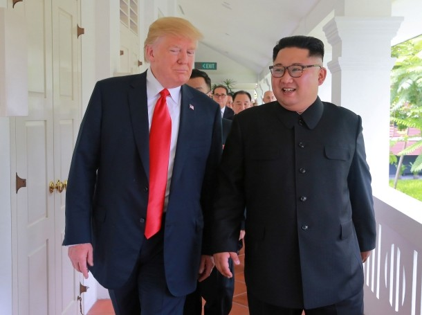President Donald Trump walks with North Korean leader Kim Jong Un at the Capella Hotel on Sentosa Island in Singapore, June 12, 2018, photo by KCNA/Reuters