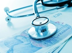 Stethoscope on top of UK 20 pound notes, photo by nito/Adobe Stock