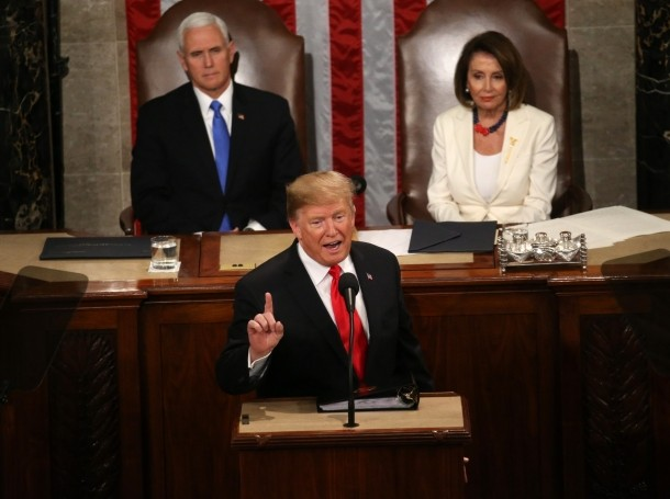 Vice President Mike Pence and Speaker of the House Nancy Pelosi listen as President Donald Trump delivers his second State of the Union address in Washington, February 5, 2019